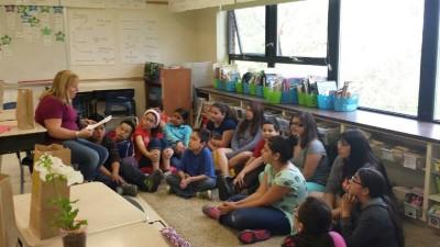 LL bibi reading to 5th graders